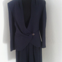 Vintage Talbot's 100% wool suit for women in size 4. Dark blue. fully lined. 'skirt-shorts'. Dark blue. Early 1990's