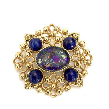 Sphinx Art Glass Brooch, Floral Gold Tone Filigree, Oval Blue Carnival Glass Center Stone, Four Faux Lapis Cabs, Vintage Designer Signed