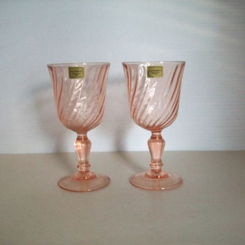 a pair of shabby pink glassware . pink wine glasses . pink goblets . rosaline glass . signed France . verrerie d' arques wine glassware