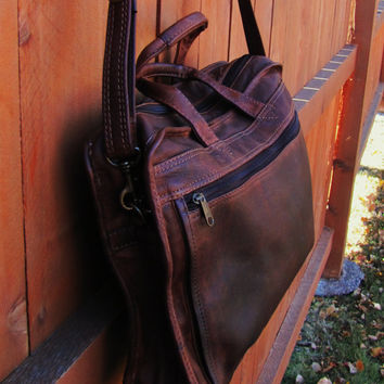 distressed dark brown unbranded leather satchel. distressed leather messenger. large capacity distressed leather briefcase