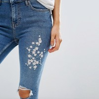 New Look Petite Blossom Embroidered Skinny Jeans at asos.com