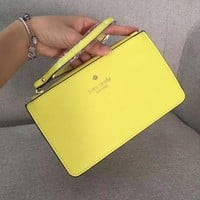 Kate Spade Simple plain color wrist bag zipper lady