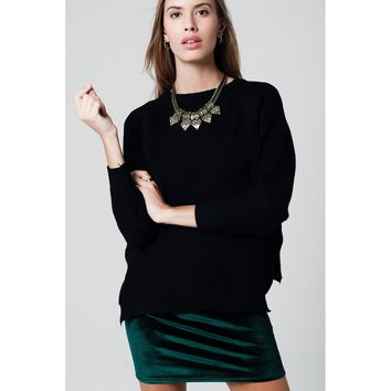 asymmetric  black sweater crossed knit with side slits