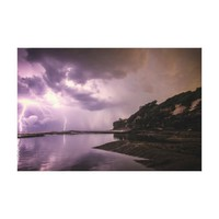 Lightning Strikes with Dark Clouds over Water Canvas Print