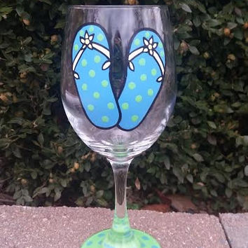 Flip Flop handpainted wine glass, blue with apple green polka dots, white straps, white flower, green base with blue polka dots