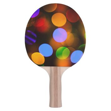 Multicolored Christmas lights. Ping Pong Paddle