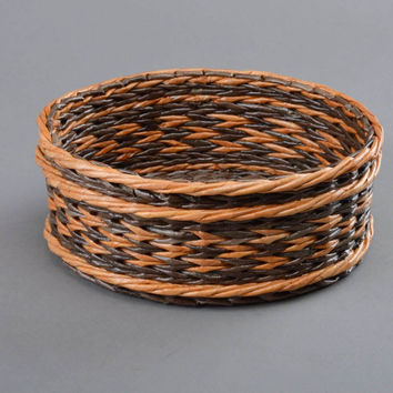 Handmade decorative round two colored brown basket woven of paper tubes