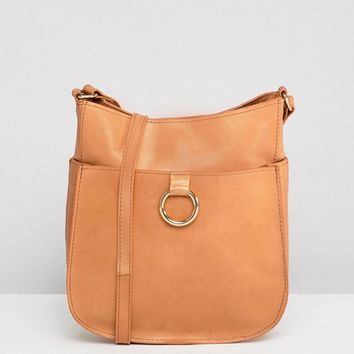 ASOS DESIGN Leather Vintage Cross Body Bag With Ring Detail at asos.com