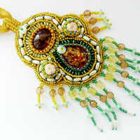 Beaded pendant Jungle on satin ribbon - golden and green seed bead embroidered jewelry - handmade beadwork - amber imitation - glass fringes
