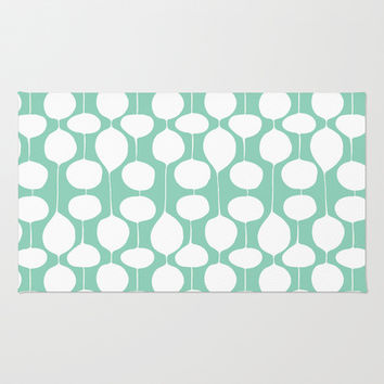 Holiday Bobbles - Festive Teal Area & Throw Rug by Heather Dutton | Society6