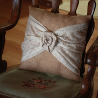 Rustic decorative throw pillow with burlap and antique lace