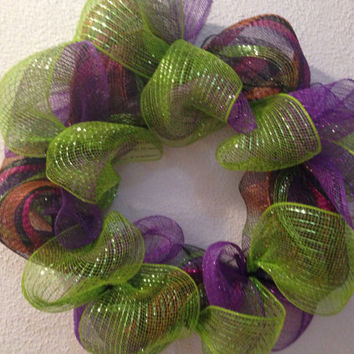 Halloween colors wreath. This wreath is made with Halloween colored deco mesh. It measures 16 inches