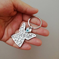 Silver angel keyring, carved aluminum small sculpture of an angel on an alloy key ring, silver angel art object, silver angel key chain