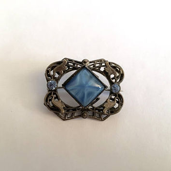 Vintage Victorian Silver Toned Filigree Brooch with Blue Rhinestones and Center Faux Star Sapphire
