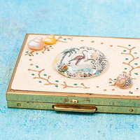 Rare vintage Florida souvenir powder compact with real seashells and reverse carved lucite featuring a flamingo at the beach. Kitschy 1950s