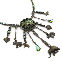 Vintage Banana Bob  Swarovski Peridot Crystal and Oxidized Cast Brass Elephant Charm Necklace