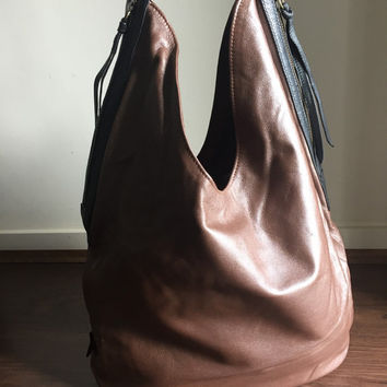 Lambskin leather, Super soft shoulder bag.Two toned and easy to open with twin zippers and zip pulls this stylish handbag holds everything.