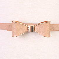 Nude High Polish Metal Trim Bow Faux Leather Belt