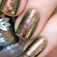 "Nail polish - ""Insipid"" green to pink multichrome flakes in a clear base"