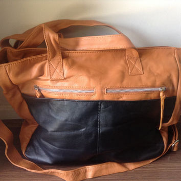 Large,soft and functional handbag. Compartments,flat handles and long straps makes a great leather shoulder tote bag