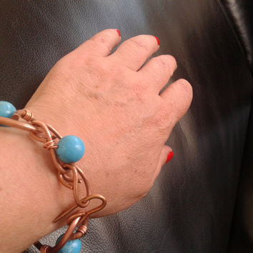 handmade bracelet of copper wire and howlite pearls