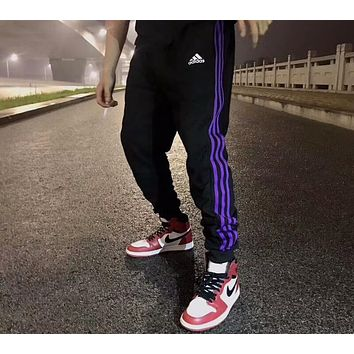 ADIDAS 2018 spring and autumn men and women models street fashion casual sports trousers F-AA-XDD Purple