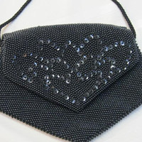 """Vintage Black Beaded with Black Sequined Evening Purse,38"""" long strap, open flaps on both sides,6"""" exterior x 9"""" at its widest point"""