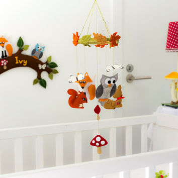 Woodland creatures nursery baby mobile with butterflies, toadstools and autumn leaves - neutral colours.