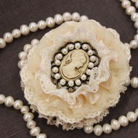 Off-white brooch with cameo