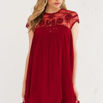 AMMO Pretty Pleated Holiday Trapeze Party Dress With Sheer and Beaded Detail in Burgundy