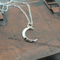 the silver new moon necklace