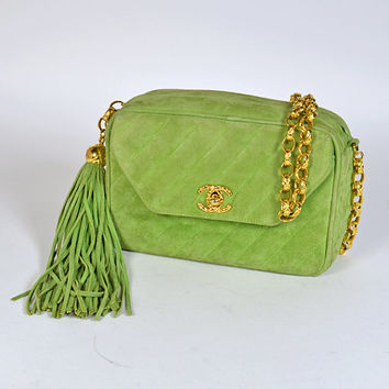 Vintage CHANEL quilted genuine suede leather green camera shoulder purse with golden chain strap and a fringe. Think Spring.