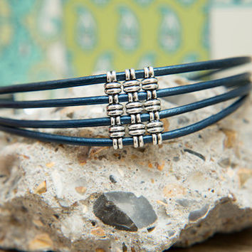 Anjea 4 banded Tribal Leather Choker with Silver features.  Blue, worn two ways, 6 leather colour options. Unique Chokers by Molax Chopa