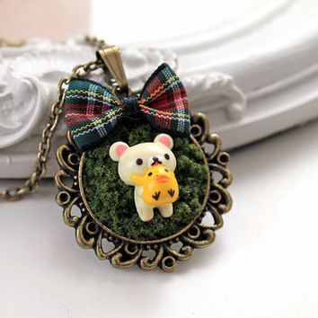 Teddy bear holding duckie in  moss Kawaii Woodland necklace
