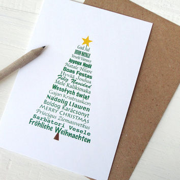 Christmas card Merry christmas in different languages greeting card green tree typography