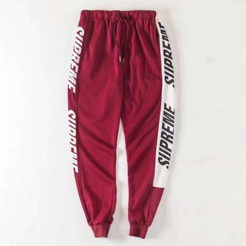 Supreme New fashion side letter print sports leisure couple pants Red