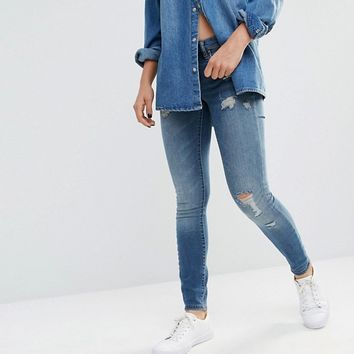 Blank NYC Mid Rise Skinny Jeans with Distresssing at asos.com
