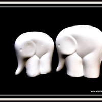 Set of two cute elephants made of white china (porcelain).