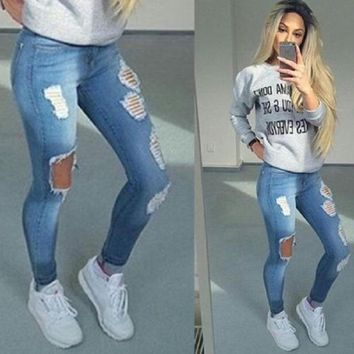 Boyfriend distressed ripped skinny fit jeans