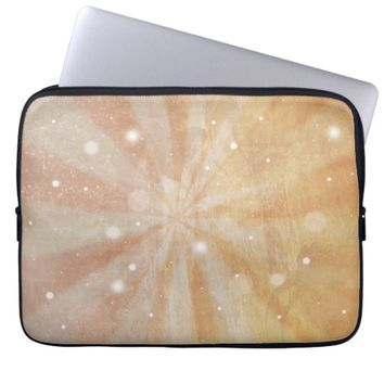 Faded orange starburst and snowflakes laptop sleeve