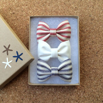 Nautical blue stripe, red stripe, and off white hair bow set from Seaside Sparrow.  Perfect 4th of July present.