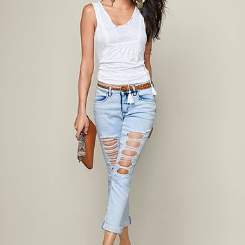 Ripped jeans, embroidered top, braided detail wedge, clutch, earrings