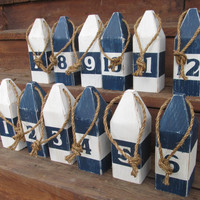 Set of 12 buoys. Nautical Table Numbers. Nautical Wedding Decor. Beach wedding. Reclaimed wood buoys. Lake Decor. Made to Order