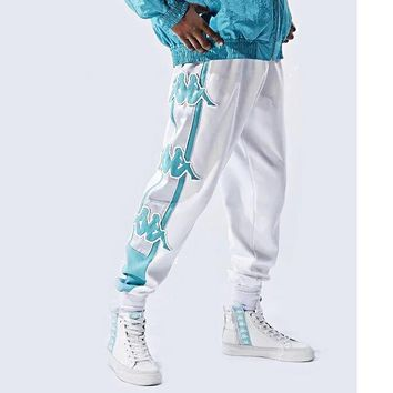 KAPPA Couple new Banda series large back string embroidery outdoor sports pants men and women casual beam feet trousers White