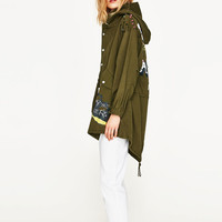 LONG PARKA WITH GRAFFITI PRINT DETAILS
