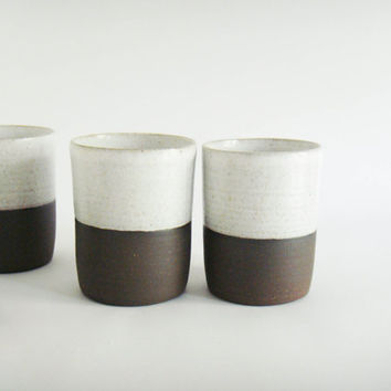 Set of four cups, white and dark brown tumbler, modern pottery
