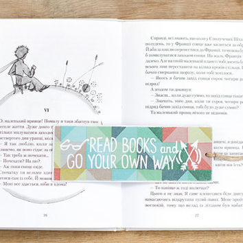 "Motivational Bookmark with a message ""Read books and go your own way"""