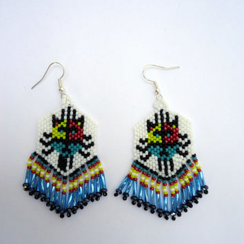 Indian style beaded cat earrings with seed beads in red,yellow,red,black,blue and white, blue bugle beads and black rondells.
