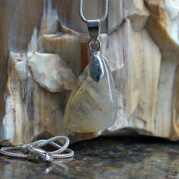 Rutilated Quartz golden rutile free form shape charm pendant with a silver plated necklace