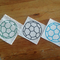 Fabric handmade drink coasters Cross stitch coasters Soccer ball patterned coasters Blue Black Green experimental pieces Blow out